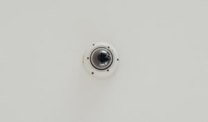 Commercial dome surveillance videocamera on a ceiling