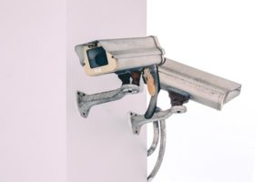 Commercial PTZ Videocamera on a wall of a building