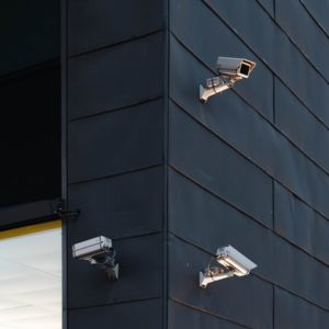 Commercial PTZ Videocameras on a Wall of a Building